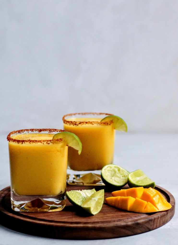 Frozen Mango Margarita with spicy Chile Lime Seasoning