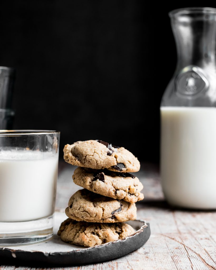 Stack of cookies and milk.