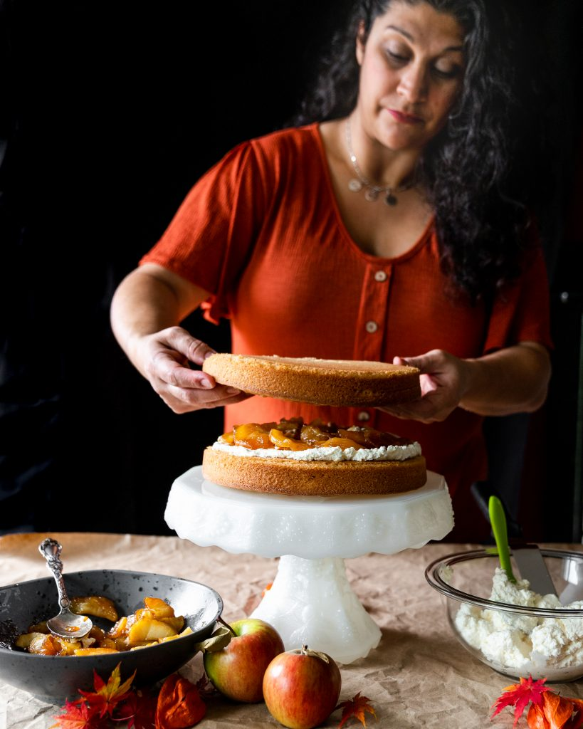 Woman assembling layer cake