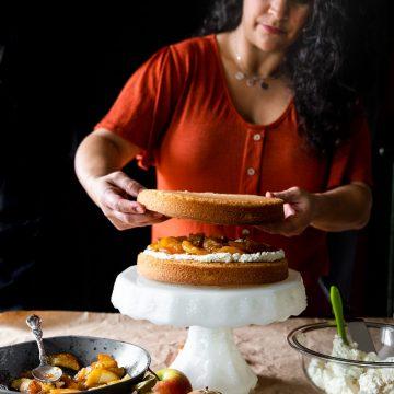 Woman assembling layer cake